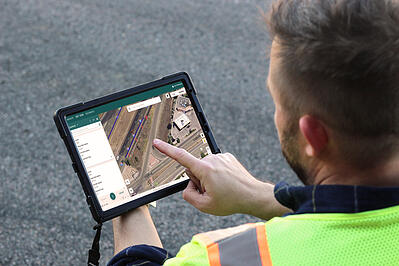Field technician using NueGOV software on a tablet