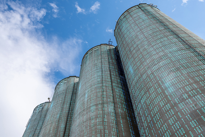 Binary code superimposed on silos