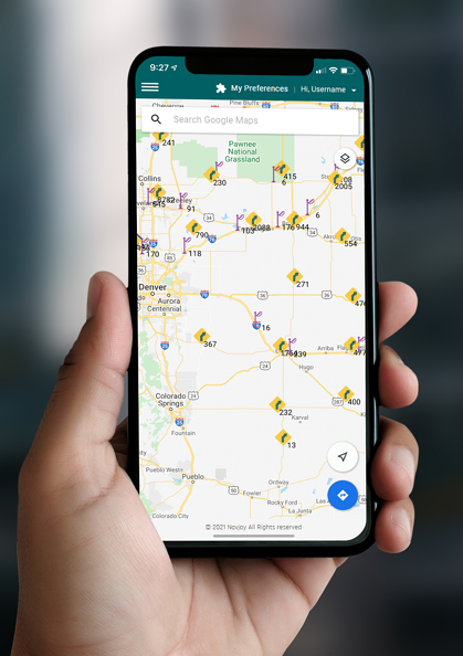 Mobile phone with NueGOV app on screen showing Google Maps digital mapping.